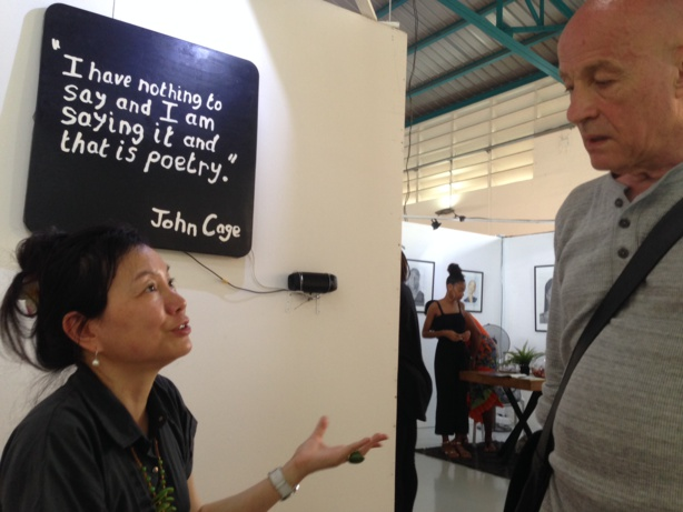 Curator Louise Tsai and André Rouillé in conversation in Joëlle Ferly's space at PooL Art Fair