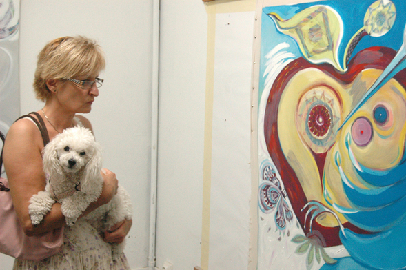 Visitor viewing the artwork of  Andreaha San (Brazil) during the  studio open days