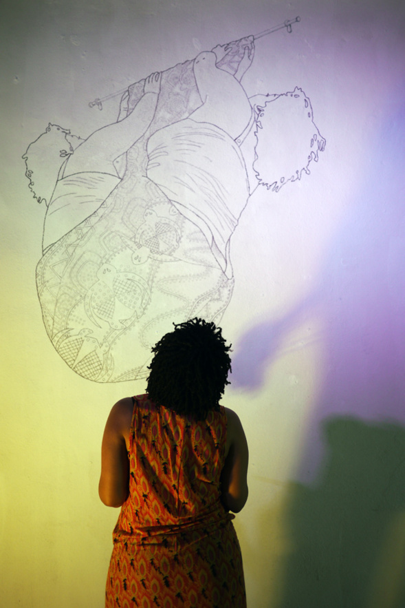Nicole Awai (Trinidad , New York) making the last touch to her drawing