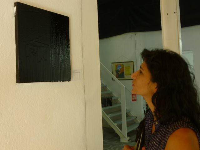 Ivelisse in front of Sebastien Mehal's painting at T&T gallery, Guadeloupe. Mehal is a member of L'Artocarpe