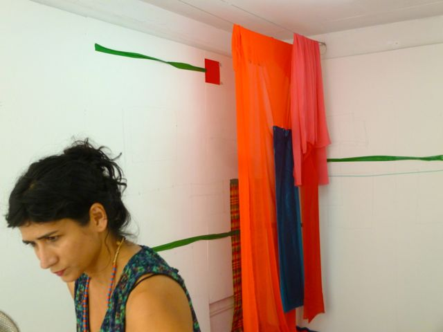 The artist Ivelisse Jimenez working on her piece at L'Artocarpe