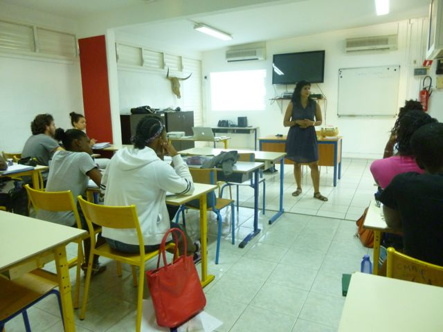 Ivelisse at the Centre des Métiers d'Art, in Guadeloupe, talking to students