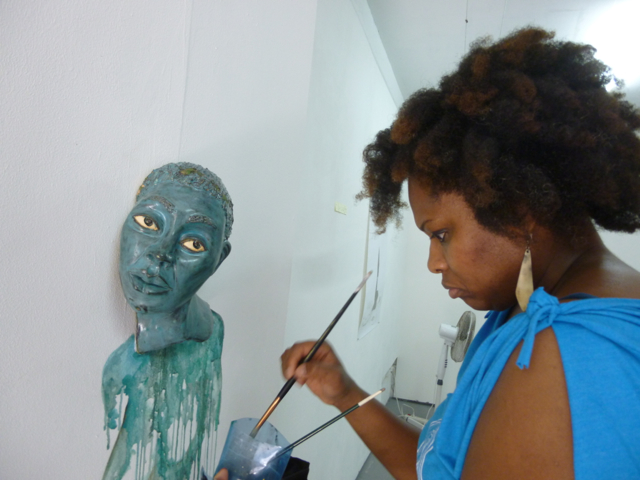 Aisha Tandiwe Bell working in the studio at L'Artocarpe
