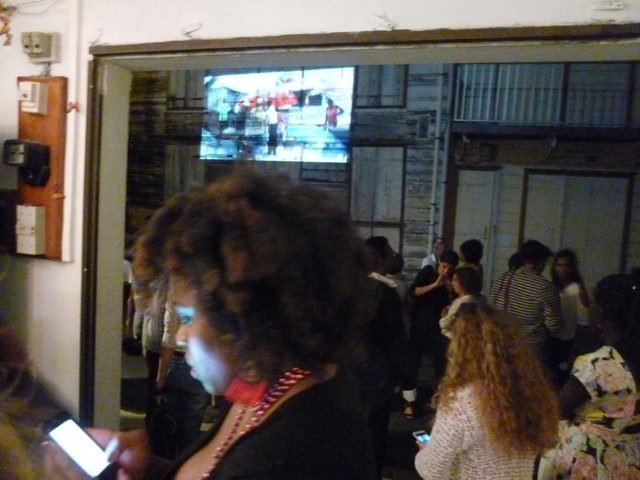 Opening of the show at L'Artocarpe. Videos projected across the street in Le Moule